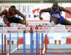 Фотофиниш реши титлата на 60 метра с препятствия при мъжете