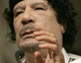 Босът на ФИДЕ мести пешките с полковник Кадафи